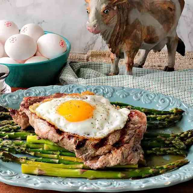 Buttery Rich Steak and Eggs Over Asparagus
